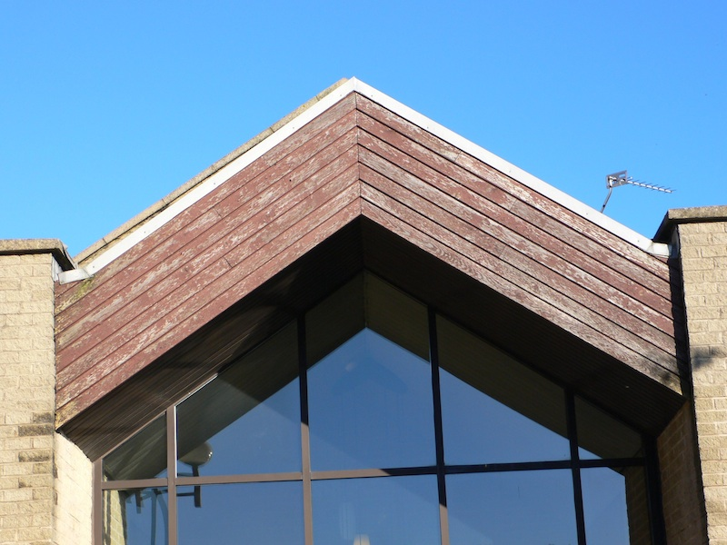 School building rotten cedar cladding